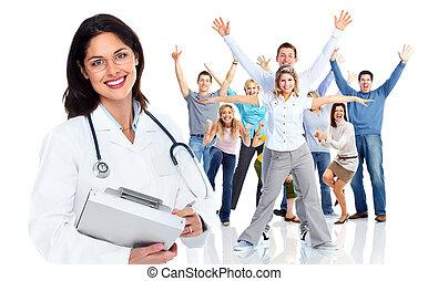 médecin de famille, femme, et, a, groupe, de, heureux, gens.