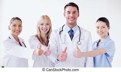 médecins, groupe, haut, pouces