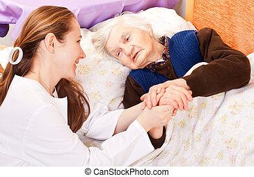 médico de mujer, asideros, joven, anciano, manos