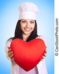 médico feminino, segurando, coração, ligado, experiência azul