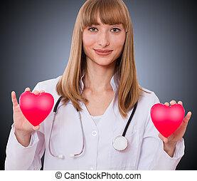 médico feminino, segurando, heart.