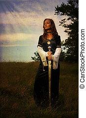 místico, medieval, mujer estar de pie, con, un, espada, en, un, salvaje, pradera