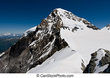 Mountaintop of M�nch. View from Jungfraujoch, Switzerland.
