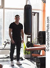 músculos, joven, doblar, perforación, bag., hombre