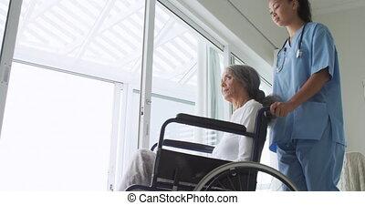 mûrir, infirmière, femme, fauteuil roulant