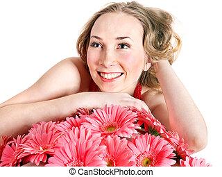 młoda kobieta, leżący, na, flowers.