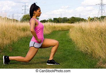 młoda kobieta, rozciąganie, outdoors.