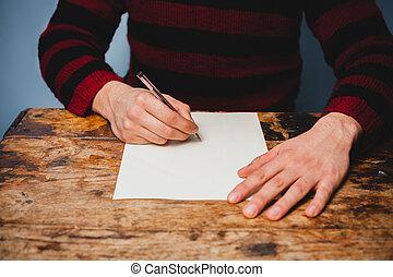 młody mężczyzna, jest, pisanie litera
