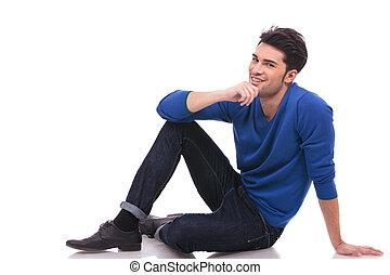 młody mężczyzna, zadumany, posiedzenie