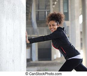 młody, ma na sobie kobietę, rozciąganie ruch, outdoors