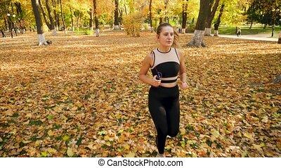 młody, ruch, video, earphones, piękny, kropka, park, jogging...