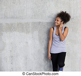 młody, sporty, kobieta uśmiechnięta, z, earphones