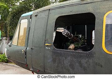 minigun in the door helicopter Bell UH-1 Iroquois