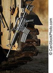 M16 Israel Army Rifle - An M16 rifle hangs over an Israeli...