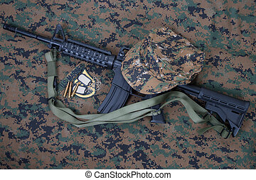 M4 carbine and blank dog tags on us marines camouflage...
