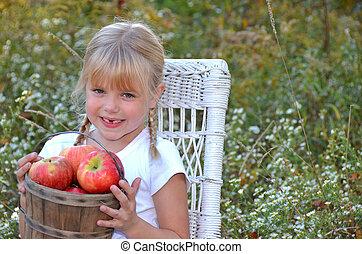 mała dziewczyna, jabłka