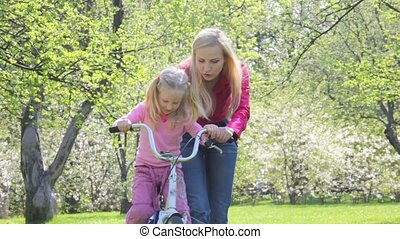 ma teaches girl to roll on bicycle