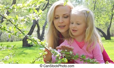 Ma with girl in garden