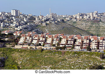 MAALE ADUMIM, ISR - MAR 25 2015:Maale Adumim settlement against the arab village al-Eizariya. It's the third largest Israeli settlement in the West Bank and a city of 40,000 residence near Jerusalem.