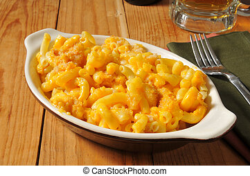 Macaroni and cheese in an individual casserole dish with bread crumbs