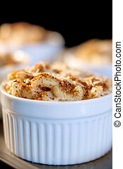 mac and cheese - homemade macaroni and cheese baking in the...
