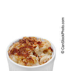 homemade macaroni and cheese in a ramekin over white with copyspace