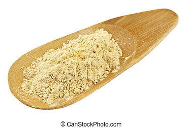 maca root powder (nutrition supplement - superfood from Andies) in a small bamboo scoop