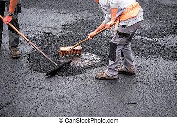 macadam worker on the road