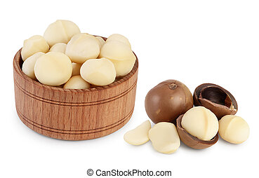 macadamia nuts in wooden bowl isolated on white background with clipping path and full depth of field