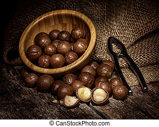 Macadamia nuts on wooden table. - Close up the macadamia ...