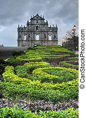 Macao landmark, ruins of St. Paul's Cathedral with green park in night in Macau, China.