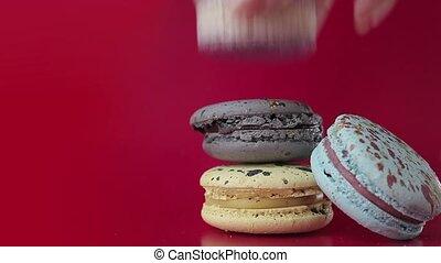 Macaron. Desserts on a bright raspberry background. Female...