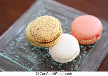 Macaron isolated in wood background