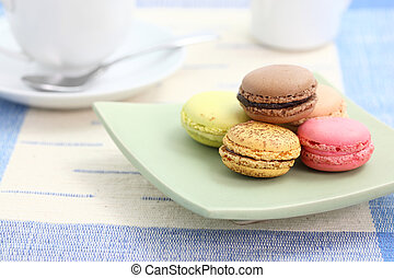 Macaron with coffee cup in white background