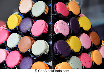 Macarones on rack - several macarones on rack in shop in...