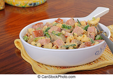 Macaroni and Cheese - Macaroni and cheese with ham in a...