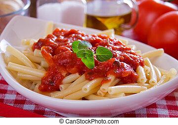Macaroni pasta with tomato sauce and oregano