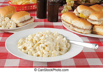 Macaroni Salad - a bowl of macaroni salad on a picnic table