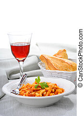 Macaroni with a tomato beef sauce served with crusty bread.
