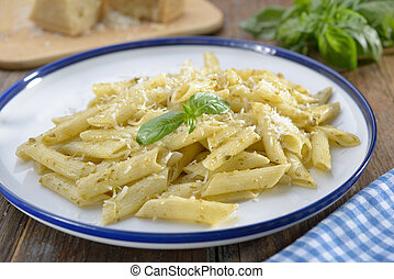Macaroni with Parmesan cheese and basil leaf