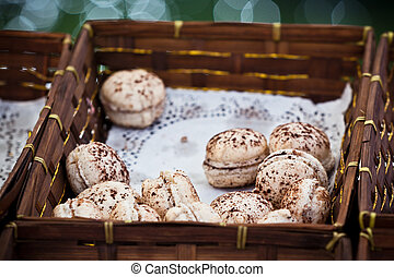 Macarons assortment in a wickered box. Horizontal shot with selective focus