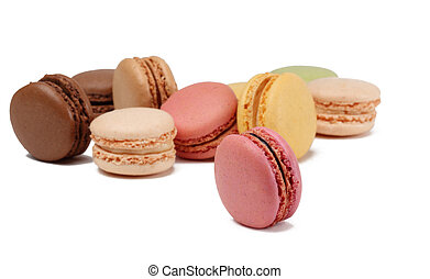 Colorful macarons against a white background. Selective focus on the pink vertical one.