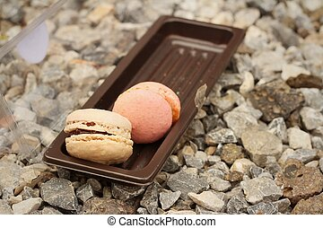 Macarons in box on a stone background