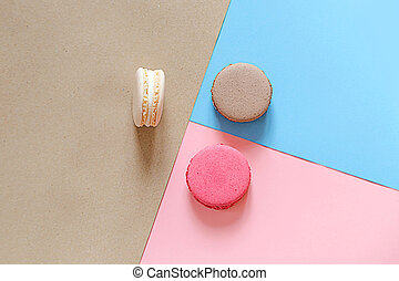 Macarons on 3 colored paper background. Top view