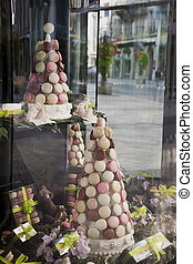 Macarons on display in a shop window