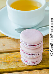 Macaroon - Grape macaroon on the wood table with white tea ...