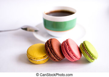 macaroons and cup of coffee on white background