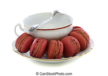 Macaroons and white cup.