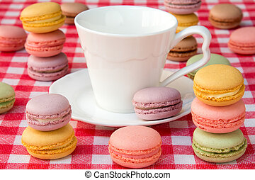 Macaroons and white cup