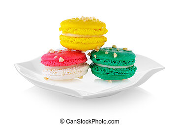 macaroons in ceramic plate (beautiful shape) on white background